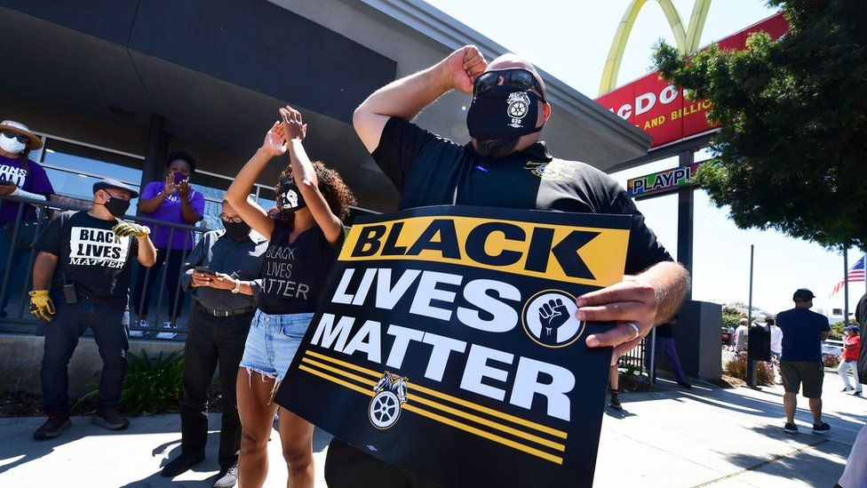 Activists protest in front of a McDonalds in Los Angeles, California, on July 20, 2020 during a Strike For Black Lives rally.