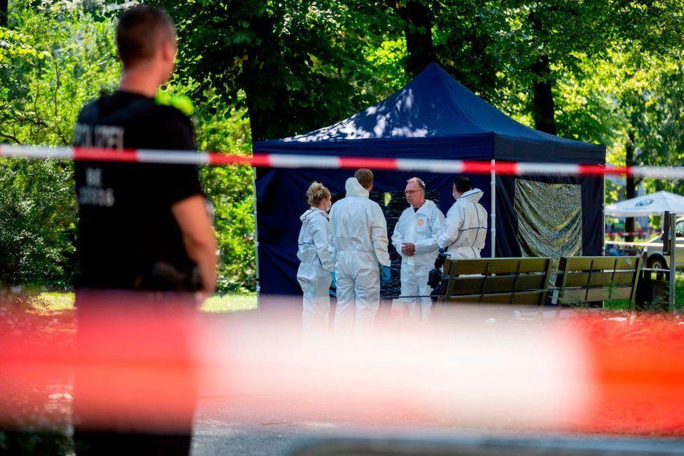 Police forensic experts examine the crime scene after the assassination of Zelimkhan Khangoshvili
