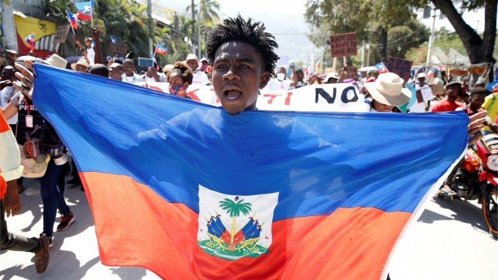 A demonstrator takes part in a march during a protest against Haiti's President Jovenel Moïse, in Port-au-Prince, Haiti February 14, 2021.