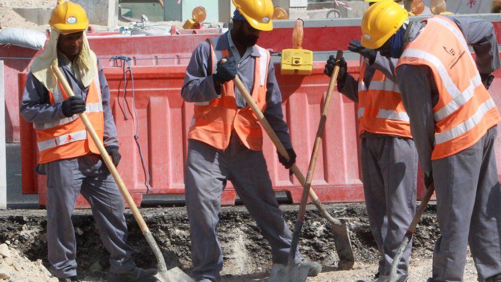 Workers at a construction site in Doha on 16 November 2014