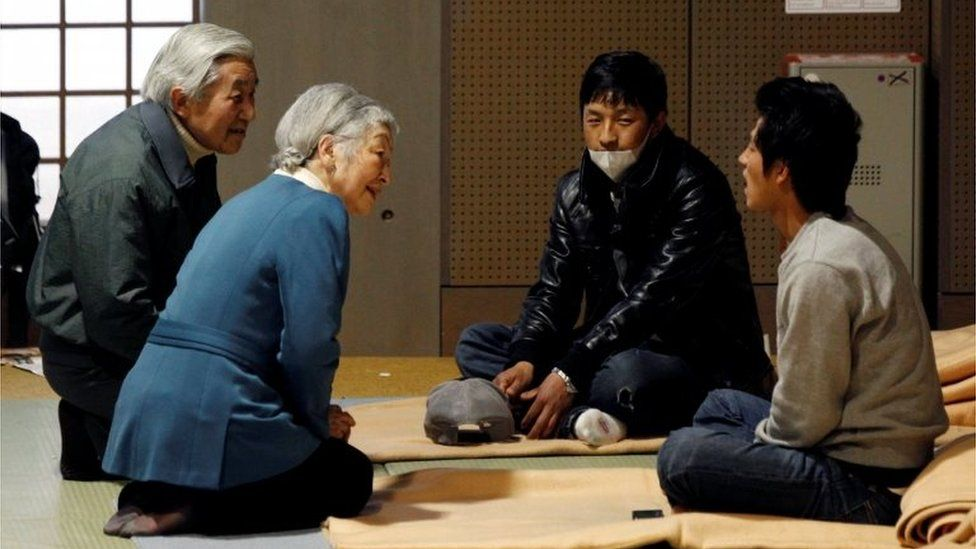 Image result for japanese king visited tsunami victims