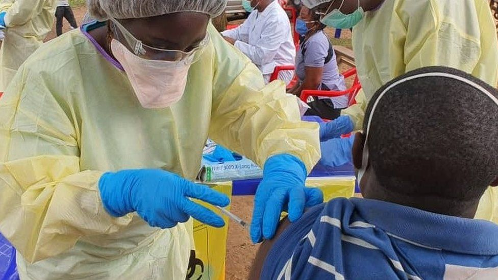 People being vaccinated in DR Congo