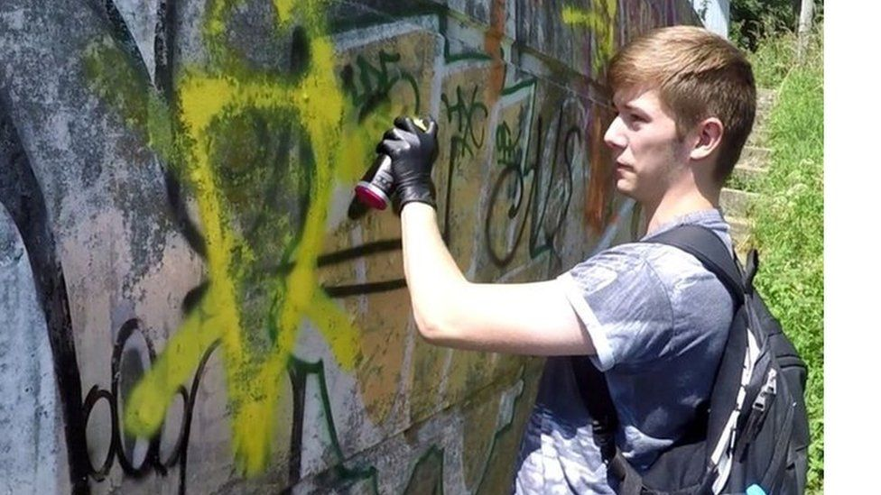 Hannam spraying graffiti