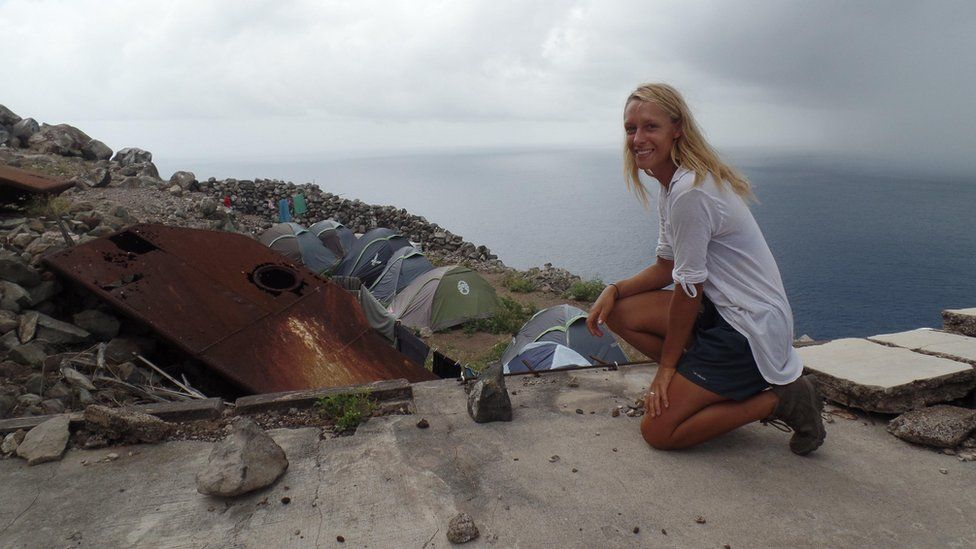 Conservationist Salina Janzan looks out over the make-shift camp