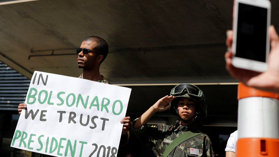 Supporters of Jair Bolsonaro stand in front of the Albert Einstein hospital after Bolsonaro was stabbed by a man in Juiz de Fora, in Sao Paulo, Brazil September 7, 2018