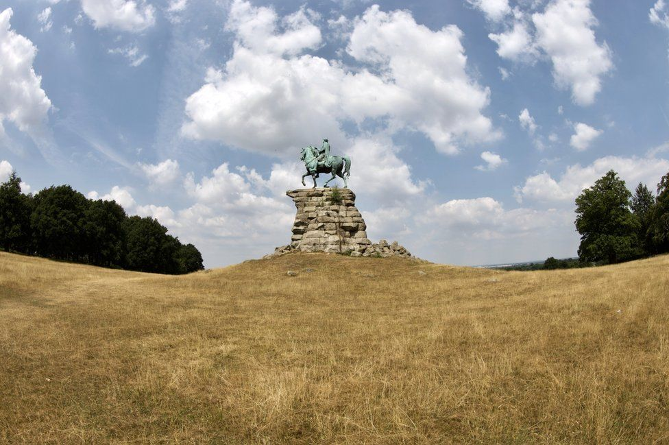Parched grass at Snow Hill in Windsor Great Park by the Copper horse on a hot day.