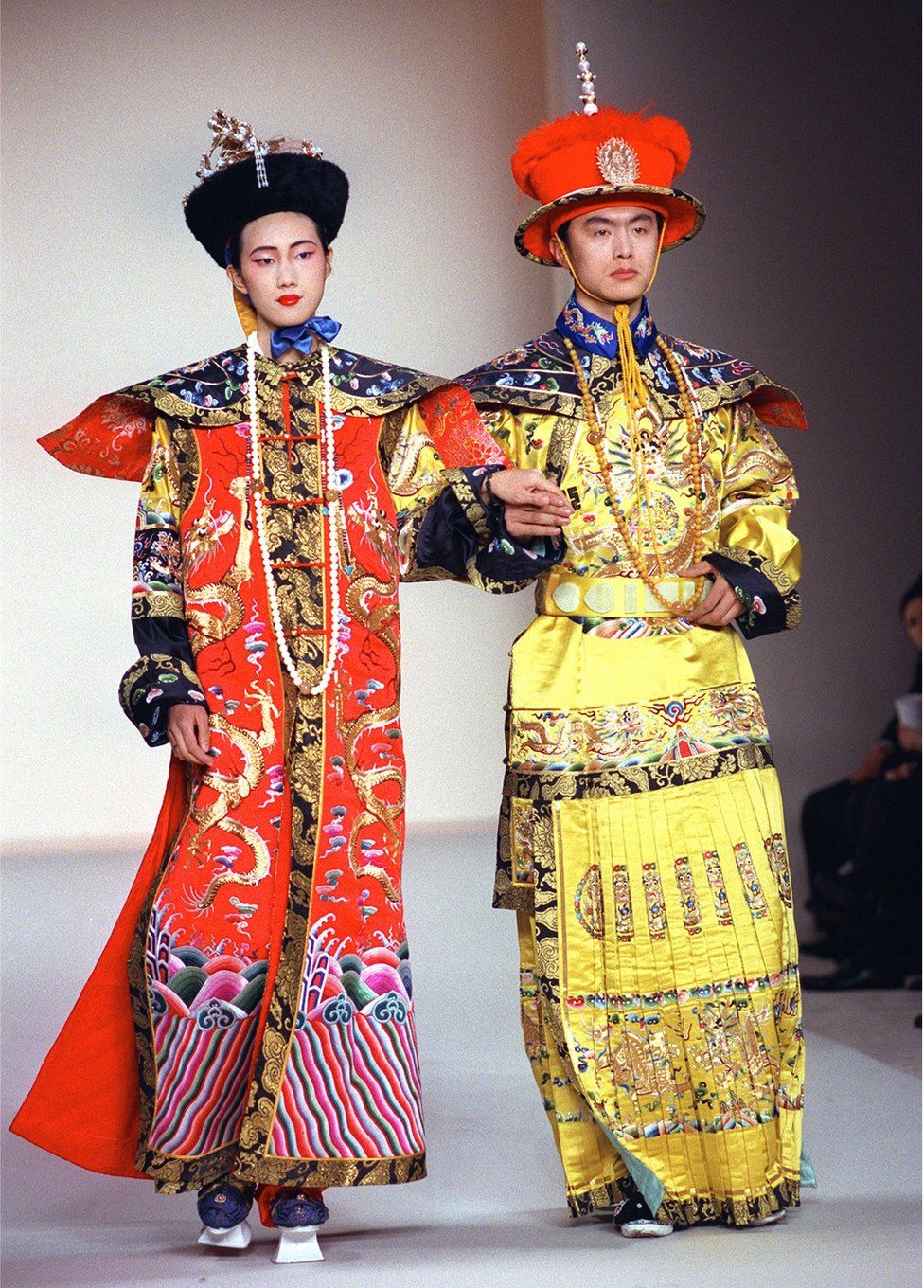 Models wear a re-creation of court robes for an Emperor and an Empress in the Qing Dynasty (1644 to 1911) of China during the China Millenium fashion show 19 February 1999 in New York.