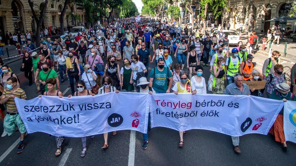 Demonstrators march towards the Hungarian Parliament Building, on Andrassy Avenue in Budapest, Hungary, 5 June 2021