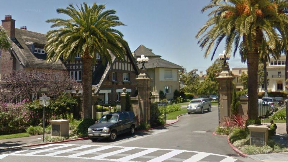 A Google street view image shows the front gate to the select neighbourhood
