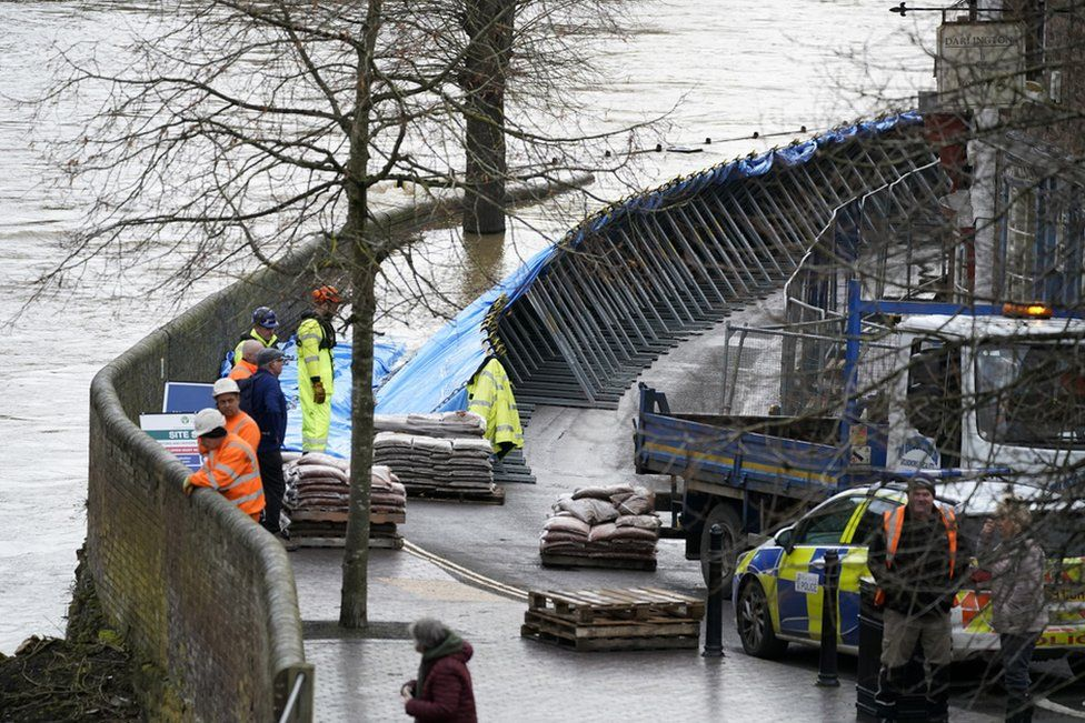 In Ironbridge, flood barriers are erected on the banks of the River Severn.