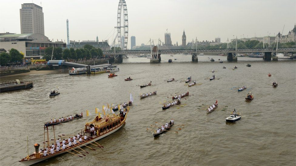 Royal barge Gloriana led a flotilla of boats down the River Thames