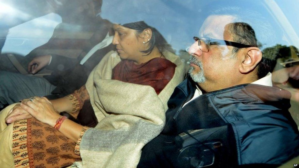 Rajesh Talwar, right, and his wife Nupur, center, are driven away by Indian police outside a court after their trial for double murder in Ghaziabad, India, Monday, Nov. 25, 2013.