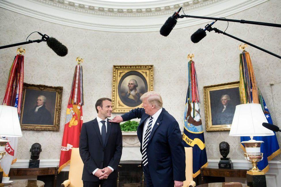 "Mr Trump wipes away ""dandruff"" from Mr Macron's shoulder"