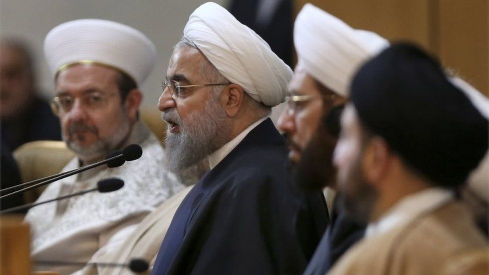 Iranian President Hassan Rouhani, second left, speaks during the 29th International Islamic Unity Conference in Tehran, Iran, on 27 December