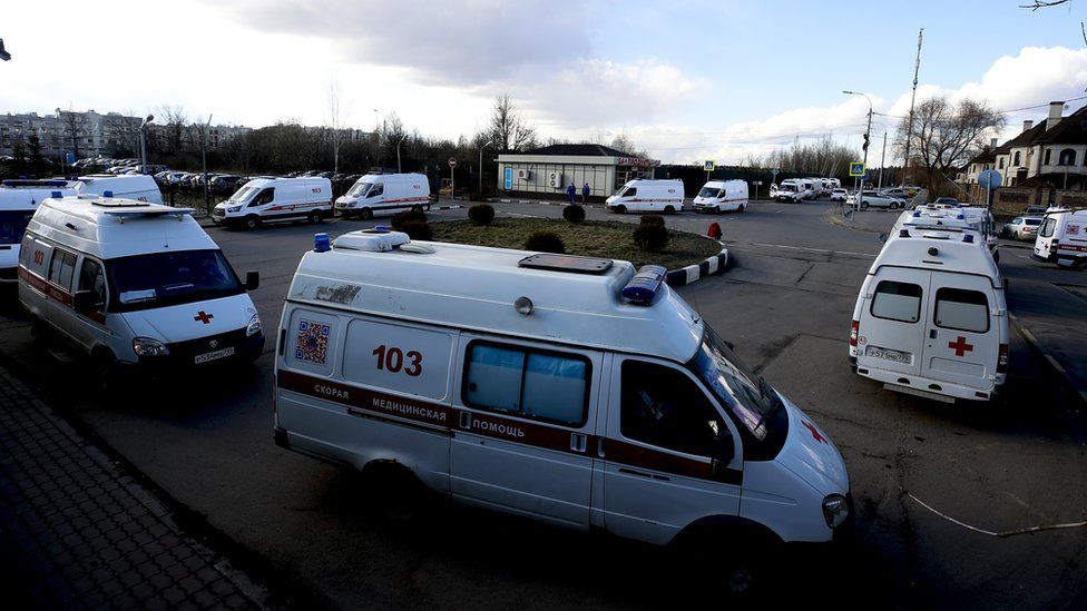Ambulance vehicles queue at the entrance to a medical clinic in Moscow