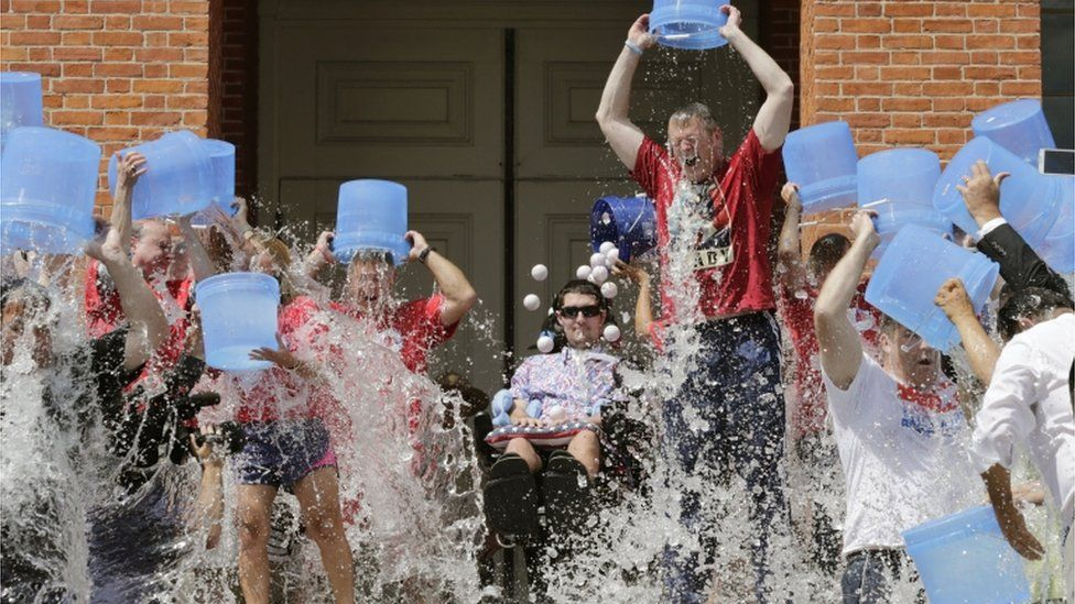 Massachusetts Governor Charlie Baker and his deputy Karyn Polito participate in the Ice Bucket Challenge on 10 August 2015 in Boston