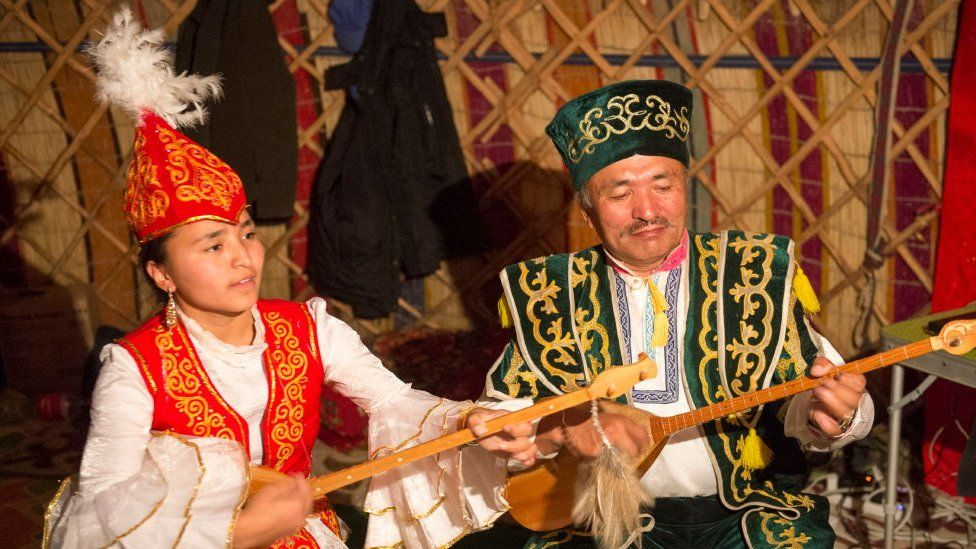 Father and daughter performing traditional Kazakh songs with Kazakh dombras
