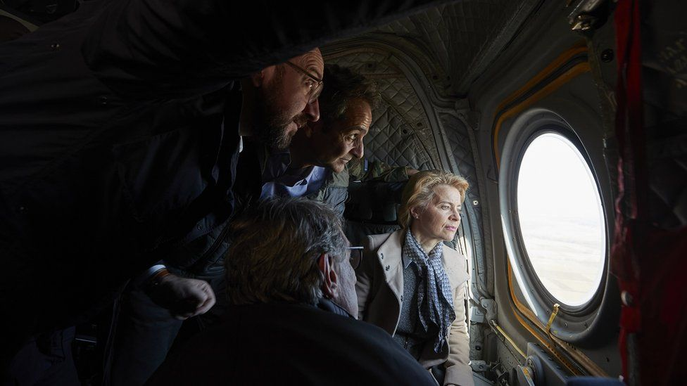 Greek Prime Minister Kyriakos Mitsotakis (2-L) with European Council President Charles Michel (L), European Commission President Ursula von der Leyen (R) and European Parliament President David Sassoli (bottom, back to camera), looking out of the window of a helicopter during a flight over Evros, at the Greek-Turkish border in northern Greece, 03 March 2020