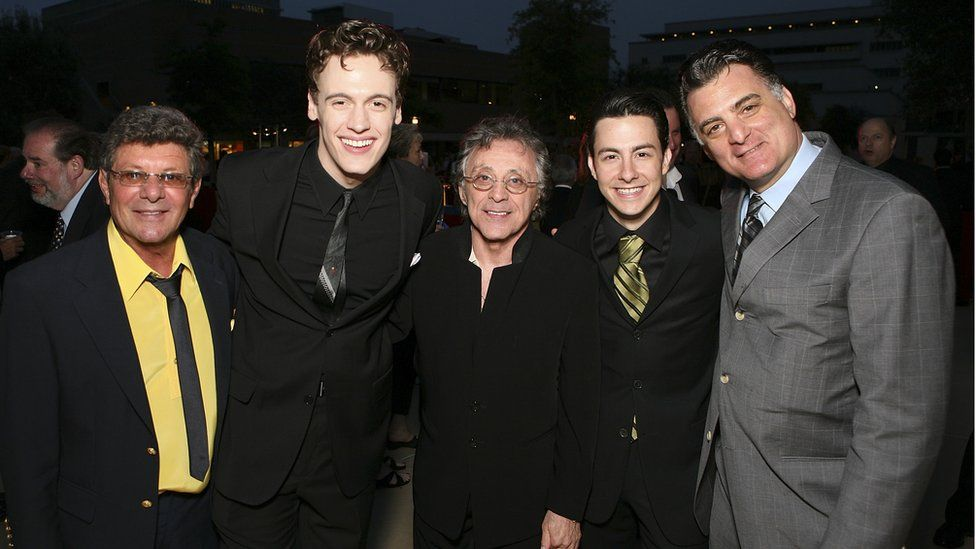 Siravo (far right) poses for pictures alongside Frankie Valli (centre) during the opening night party for Jersey Boys the 2006