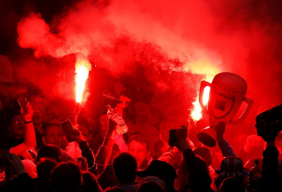 Fans celebrate at Ibrox