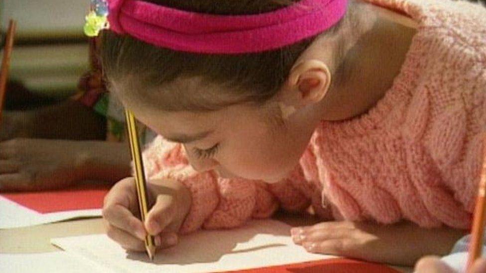 child doing test