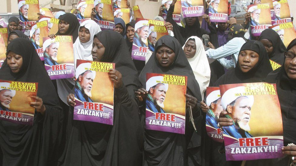 Followers hold posters of Ibrahim Zakzaky during a protest demanding his release, at the offices of the Nigeria Union of Journalists (NUJ) Secretariat, in Kaduna, Nigeria January 5, 2016