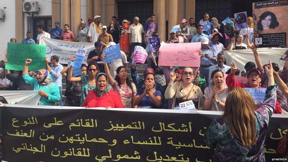 People protesting outside the court ahead of the court case for two girls who have been charged with gross indecency for wearing skirts in a market in Inezgane in Morocco 06 July 2015
