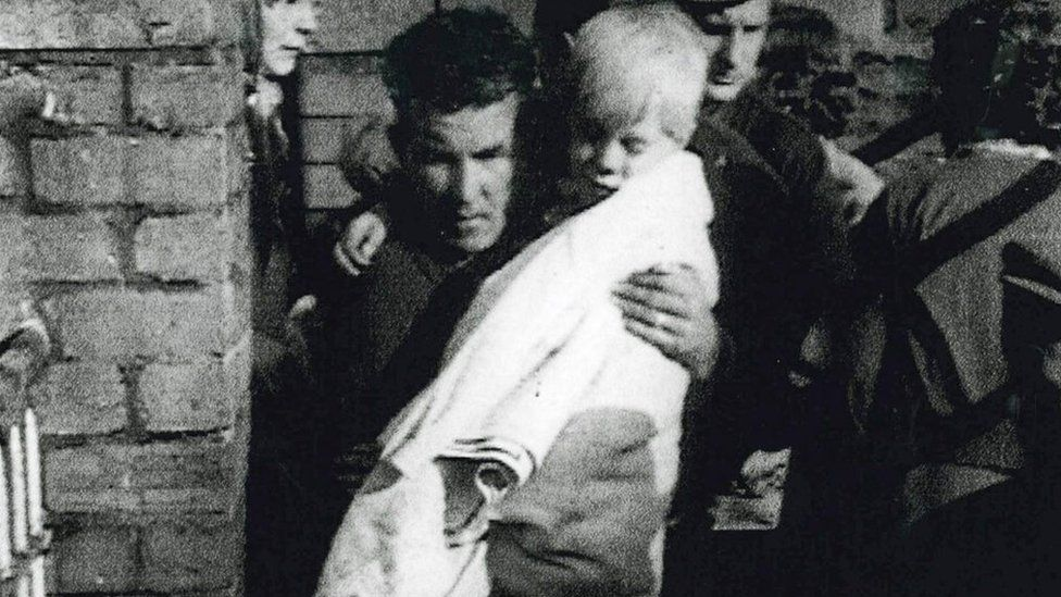 Jeff Edwards being carried out of the wreckage of Pantglas Junior School, Aberfan