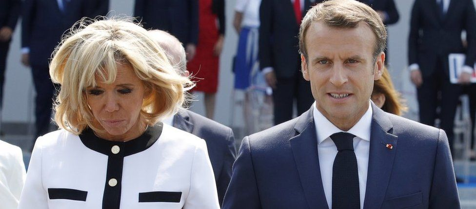 French President Emmanuel Macron and his wife Brigitte Macron leave after the traditional Bastille Day military parade on the Champs-Elysees avenue in Paris, France, 14 July 2018