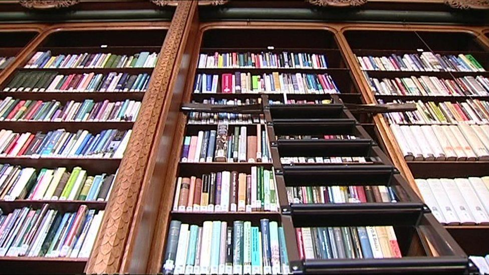 Shot from below of library shelves