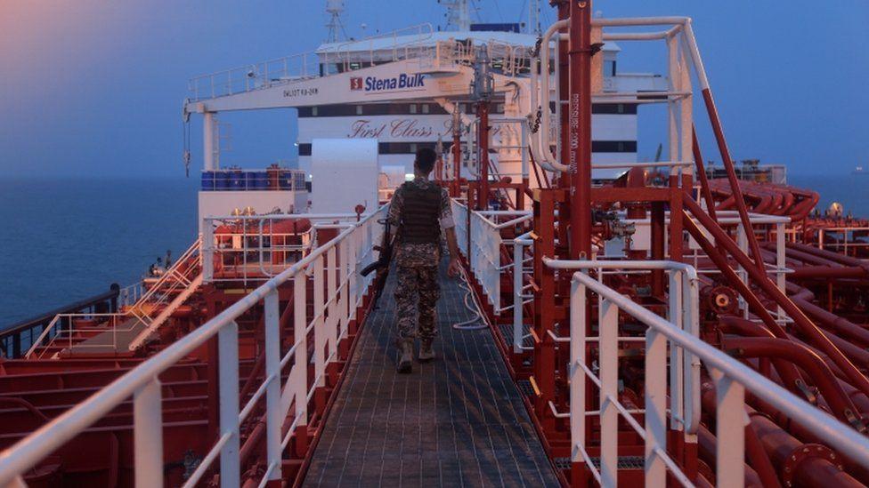 An Iranian Revolutionary Guard member walks onboard the Stena Impero