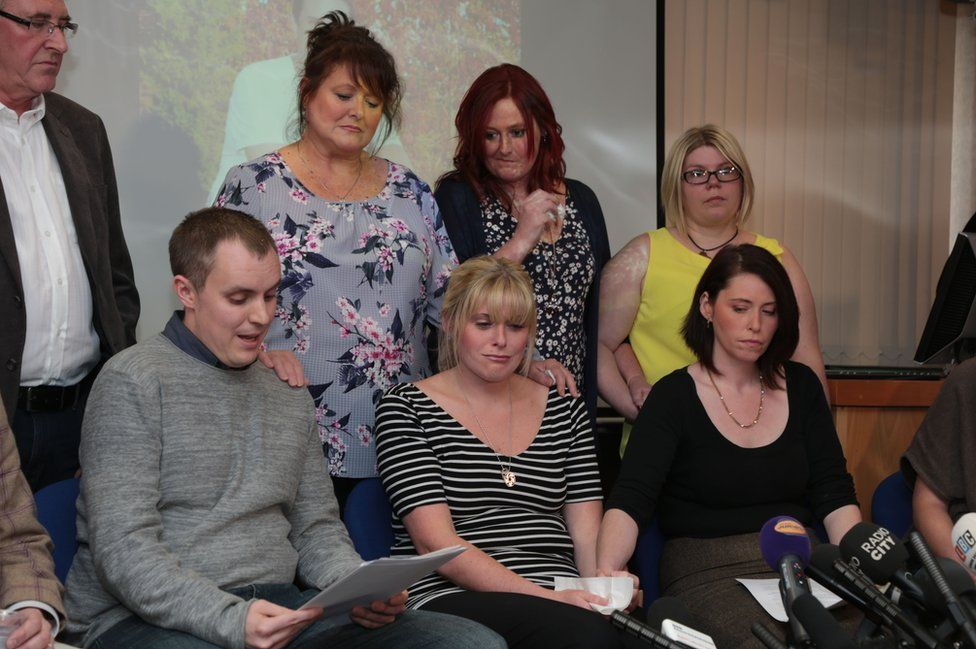 Pc David Phillips' best friend Dave George (front row, left) reads a statement as his family and friends look on including his wife Jen (front, centre) and sister Hannah Whieldon (front row, right) as they attend a press conference at Merseyside Police headquarters
