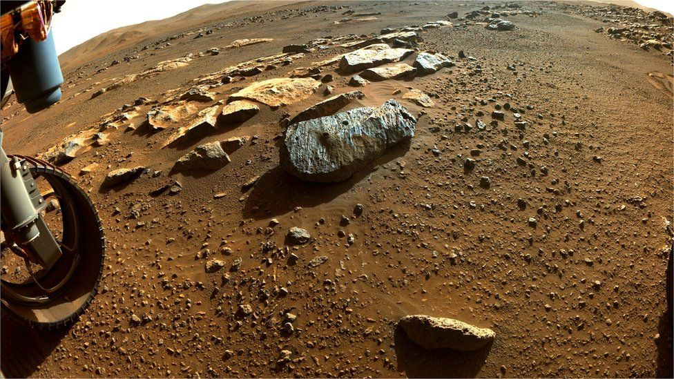 The rock slab known as Rochette with the two drill holes made by the rover