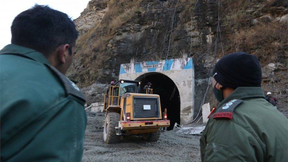 Indian rescuers work near damaged Dhauliganga hydro power project in Chamoli district, Uttrakhand, India, 08 February 2021.
