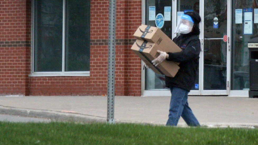 Amazon delivery in mask and gloves