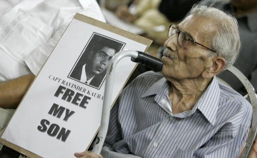 L. D. Kaura holds a photo of his missing son Captain Ravinder Kaura during a press conference organised by the Missing Defence Personnel Relatives Association in New Delhi, 05 September 2005.