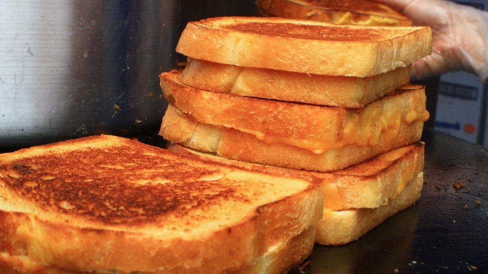 Grilled cheese sandwiches on a griddle