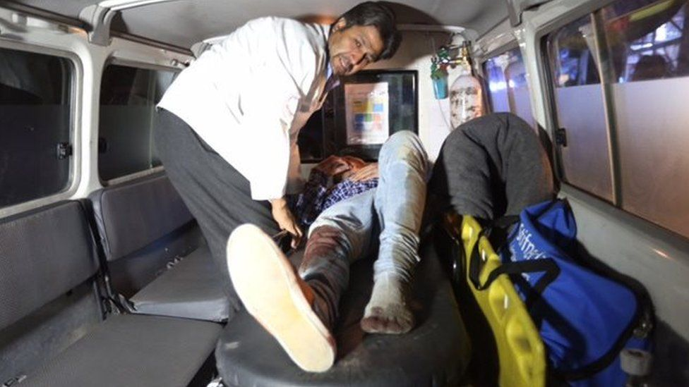 A wounded person is treated in an ambulance after a Taliban attack on the campus of the American University in the Afghan capital Kabul on Wednesday, 24 August 2016