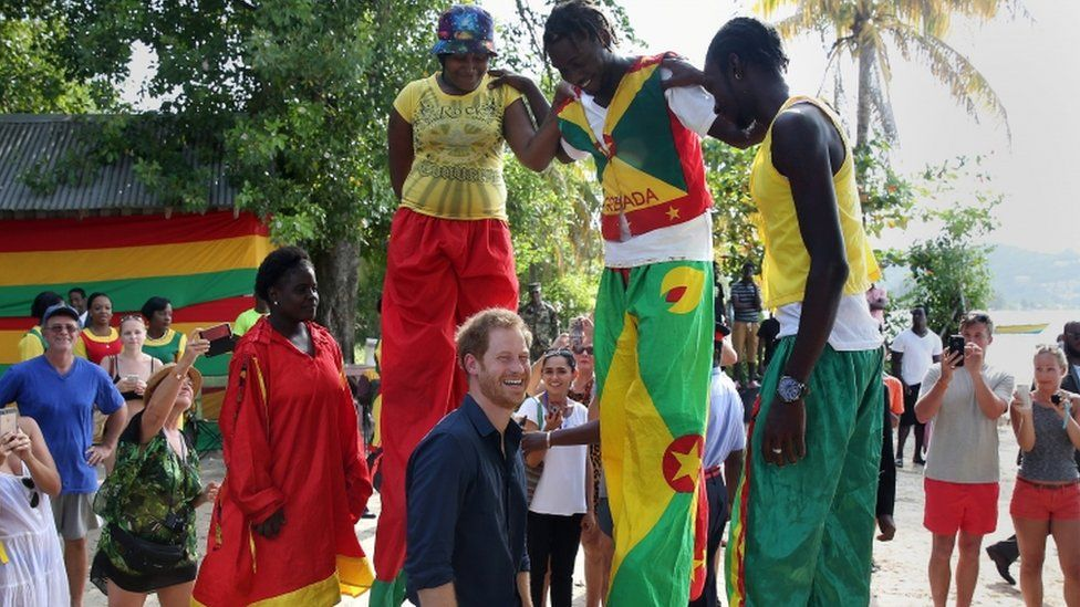 Prince Harry with stilt walkers