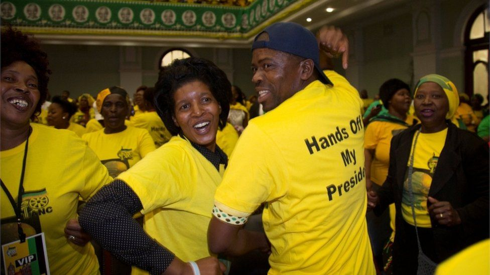 Supporters of South African President Jacob Zuma sing and dance as they await his arrival at the City Hall in Pietermaritzburg, South Africa, November 18, 2016