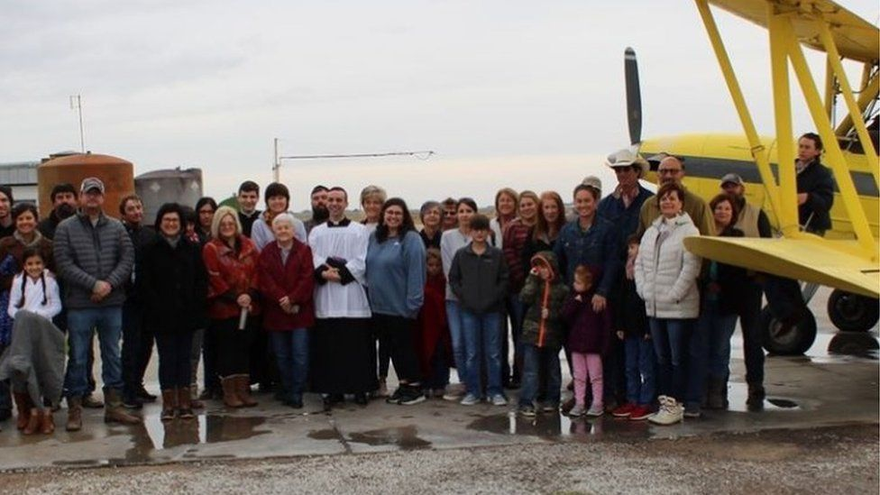 Parishioners of Cow Island in Louisiana before holy water is sprayed from a plane, 24 Dec 2019