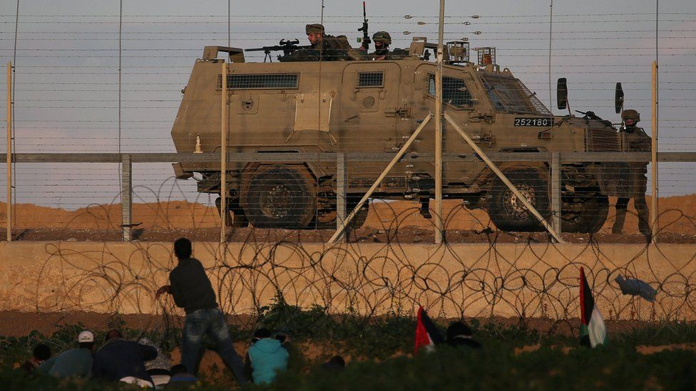 Israeli troops take position during a Palestinian protest at the Gaza-Israel border fence in the southern Gaza Strip on 18 January 2019
