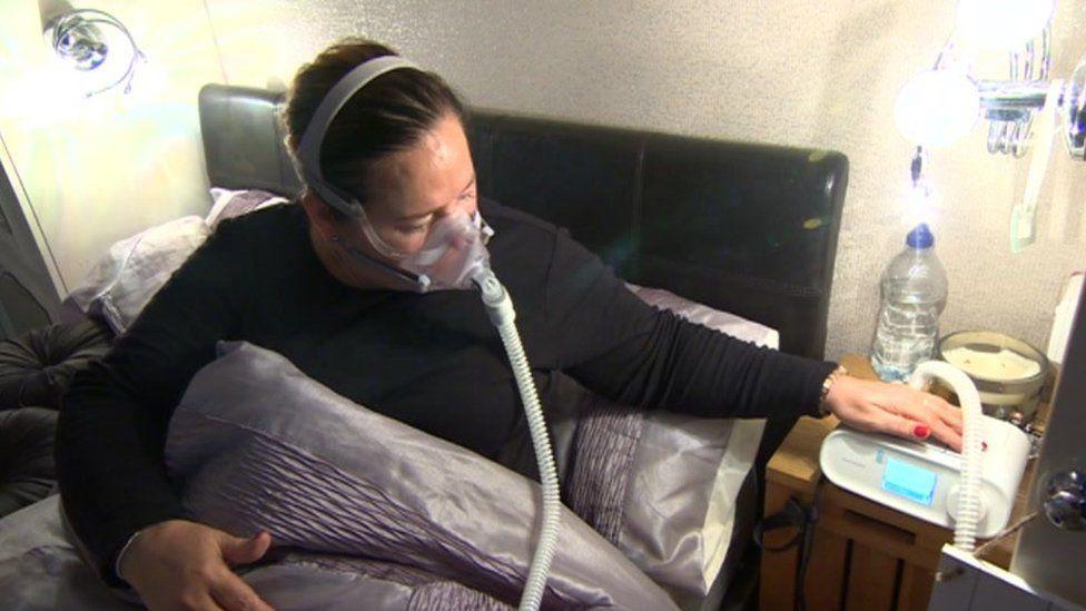 Josie Beatson in bed wearing her face mask