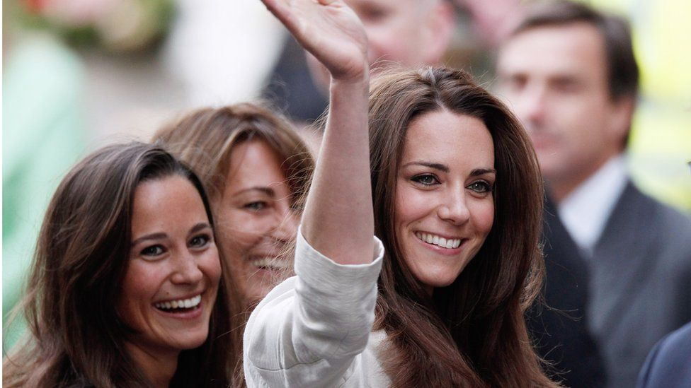 Catherine pictured with her sister Pippa and mother Carole