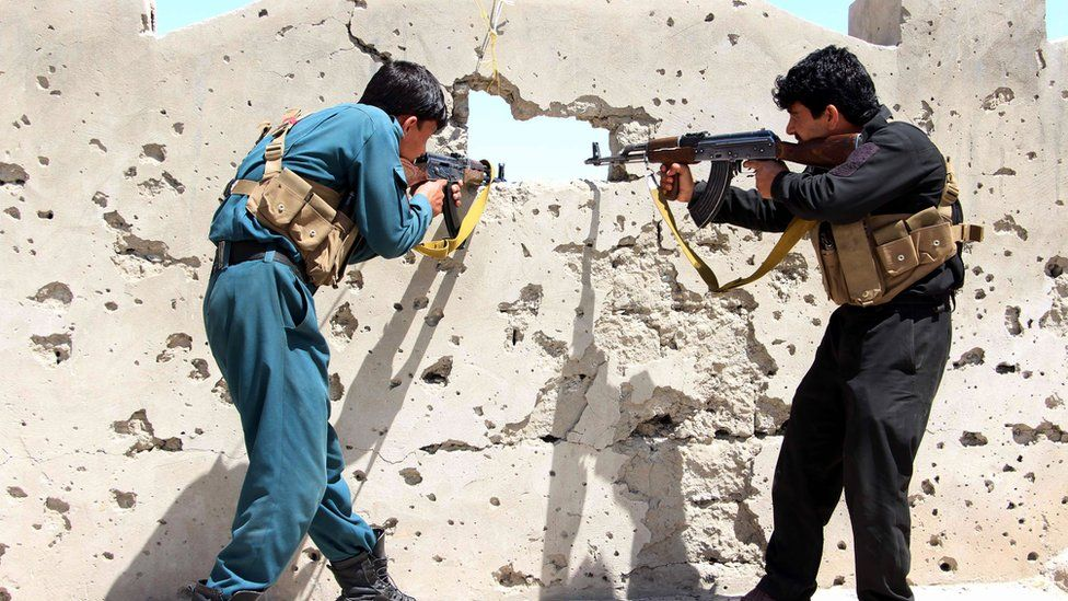 Members of the Afghan security forces take position during an operation against Taliban fighters in Nad Ali district of Helmand province, Afghanistan on 8 April 2017