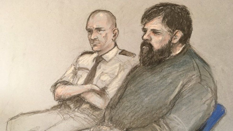 Court sketch of Carl Beech sitting next to a court security man