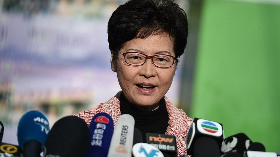 Hong Kong Chief Executive Carrie Lam speaks to the press after casting her vote during the district council elections in Hong Kong on November 24, 2019
