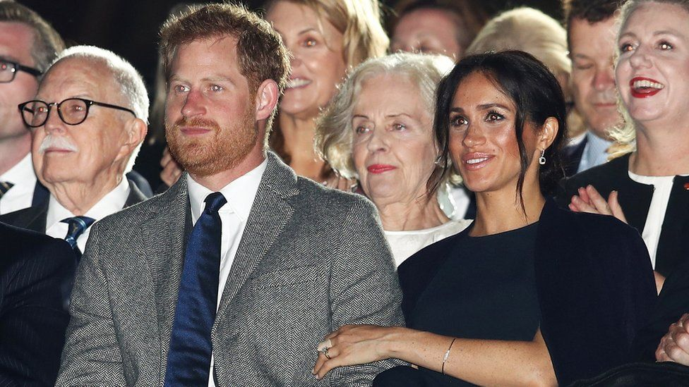 Harry and Meghan watching the opening ceremony