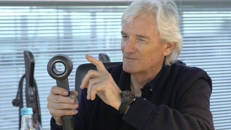 Sir James Dyson holds his new hairdryer