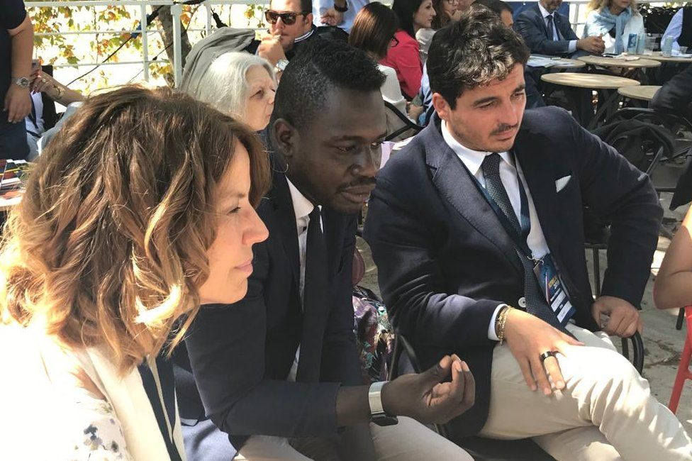 Diop leading a session about migration to Italy